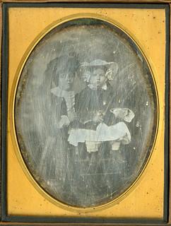 Sad, Scratched Half Plate Daguerreotype of Two Children