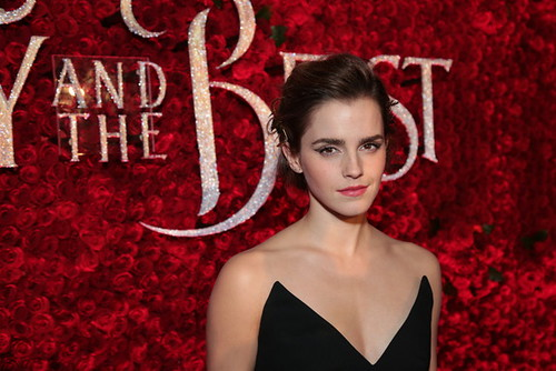 Emma Watson, who plays Belle, in front of rose wall | by kurmanstaff