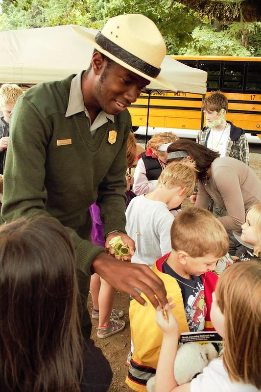 Ranger Masyih Distributing Junior Ranger Badges
