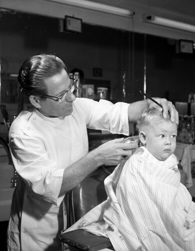 Dorian Stripling getting his first haircut in Tallahassee, Florida | by State Library and Archives of Florida