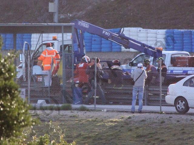 Kimi Raikkonen's Ferrari is recovered at Formula One Winter Testing 2014
