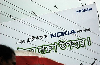Nokia, huge billboard, power lines, man's head and top of rickshaw, Dhaka, Bangladesh