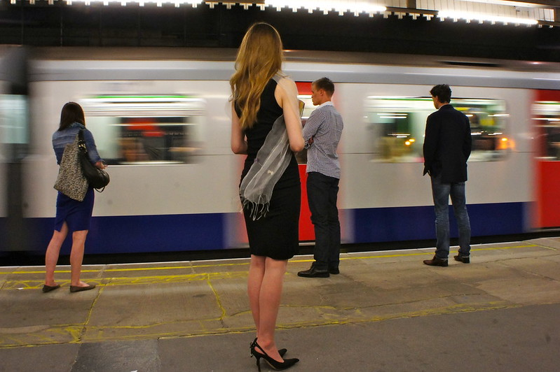 woman and other people on a metro platform