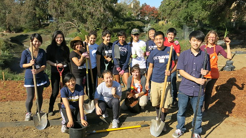 Volunteers from the UC Davis student community service day help plant the eastern bank of the Arboretum waterway with California native grasses | by UC Davis Arboretum & Public Garden