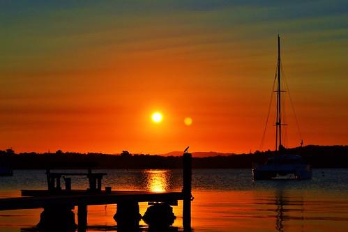 blue sunset red orange lake black reflection water silhouette boat dock view yacht jetty seat australia catamaran nsw newsouthwales mast centralcoast lakemacquarie manneringpark