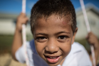 A young boy on a swing at the Maamatoa Kindergarten in Vaololoa a suburb of the capital Nukuʻalofa. AusAID supports a range of education and early education projects in Tonga. | by DFAT photo library