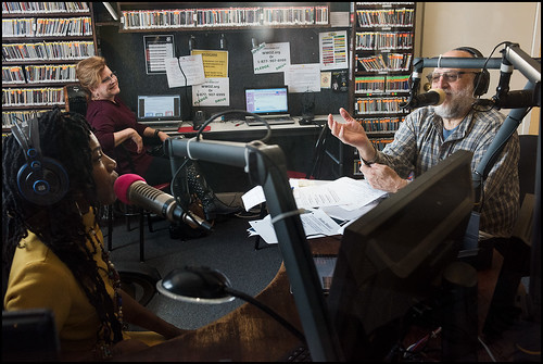 Cole WIlliams and Arthur Cohen on air, while Vickey Maples watches the phone bank, on Day 1 of the WWOZ Spring Pledge Drive. Photo by Ryan Hodgson-Rigsbee www.rhrphoto.com