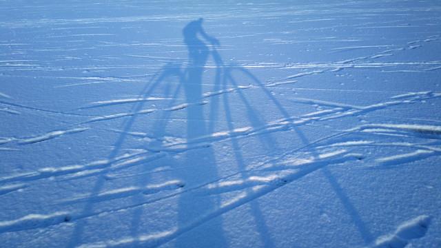 Winter cycling shadow in Helsinki