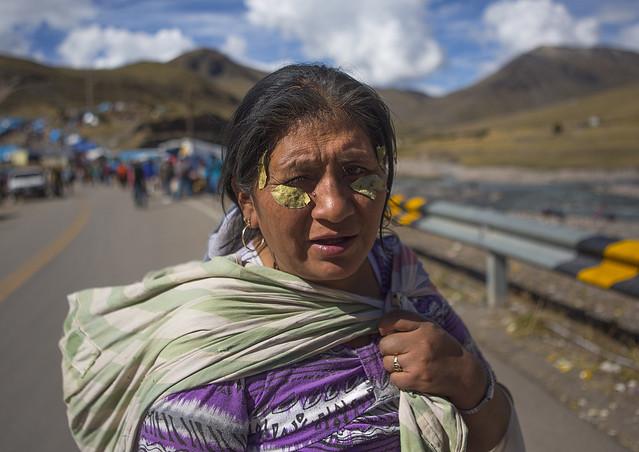 Woman With Coca Leaves On The Face To Cure Headache, Qoyllur Riti Festival, Ocongate Cuzco, Peru
