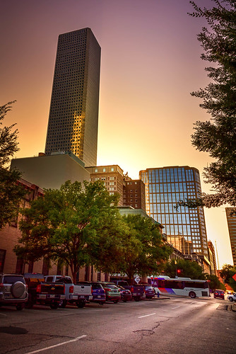 skyscaper buildings houston texas downtown city cityview cityscape street road cars bus sunset sunsets sunrise sunrises trees town