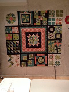 Blocks on outside by Sew Modern Quilt Bee quilters. Centre medallion area by me today. I've had these blocks for two years. Two more borders and it will be ready for quilting. :)