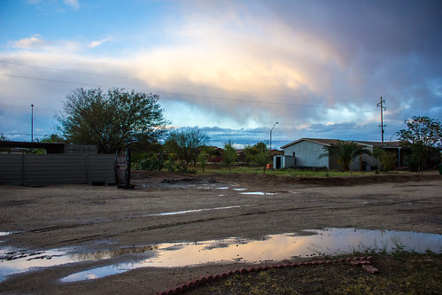 sunset arizona sky cloud reflection wet water rain puddle evening twilight mud overcast az dirt rainy soggy soaked