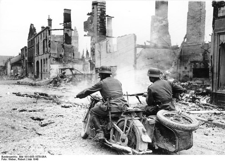 German Sidecar enters into a ruin of French town. 1940.