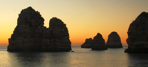 sea sky orange portugal sunrise rocks shoreline algarve