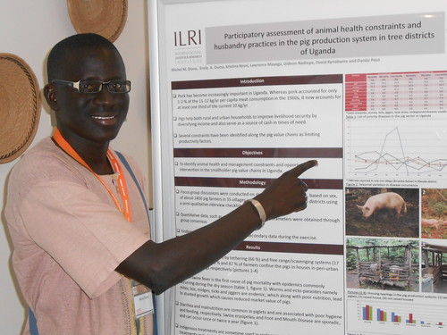 Aug/2013 - Michel Dione presents a poster at the 14th International Conference of the Association of Institutions for Tropical Veterinary Medicine (AITVM) (photo credit: Krstina Rosel).