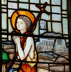 The young St John the Baptist with Haddiscoe church by Martin Travers, 1929