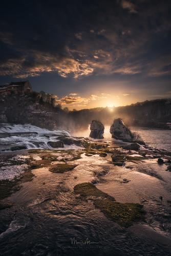 switzerland rheinfall schaffhausen drama lightdrama magic enchanting fairytale forest hills rocks stones trees woods waterfall river snow clouds glow sunset evening ch