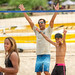 Then Tech. Sgt. Alfred Van Gieson, now Master Sgt., a reservist air transportation specialist with 48th Aerial Port Squadron, 624th Regional Support Group, Joint Base Pearl Harbor-Hickam, and his son, Makoa Kekaula-Van Gieson, celebrate a point in volleyball during a party at the Leeward Kai Canoe Club at Kalaianaole Beach Park in Nanakuli, Oahu, Hawaii, Aug 13, 2016. Van Gieson, an Air Force reservist, is a veteran of Operation Iraqi Freedom, a world champion outrigger, or Va'a, paddler and the coach at the canoe club, which was founded by his grandparents, where he tries to be a positive influence in the lives of local kids who hang out at the beach like he did when he was their age. (U.S. Air Force photo by J.M. Eddins Jr.)