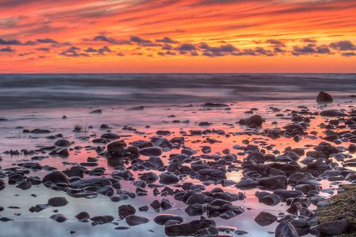 sunset orange lake beach water rocks long exposure purple huron hdr