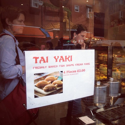 Tess patiently awaits her tai yaki | by Texarchivist