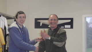 Andrew Coffin receiving from Will Perry the Junior Sprint Race Trophy | by PLSC (Panmure Lagoon Sailing Club)