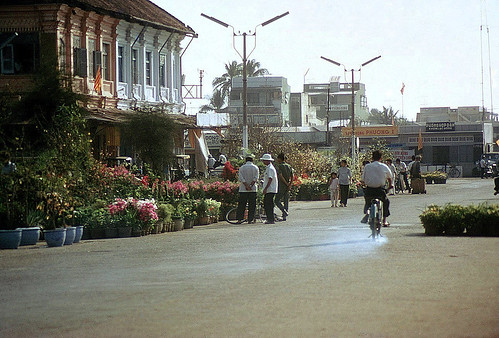 My Tho 1972 - Tet Holiday - Street parallel to the river. Chu Long restaurant to the right | by manhhai