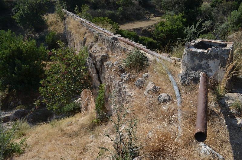 Loukou: Roman aqueduct bridge 7, modern water pipes, looking SSE