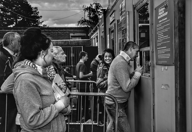 Queueing to buy tickets at Bristol Rovers football game