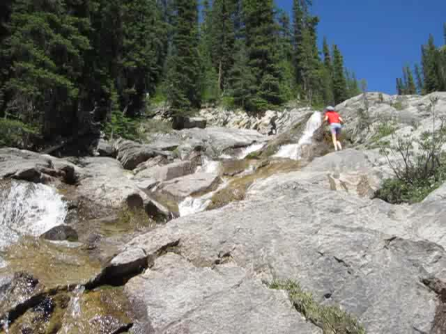0310 Video of the Cascade River cascading down a long smooth granite chute