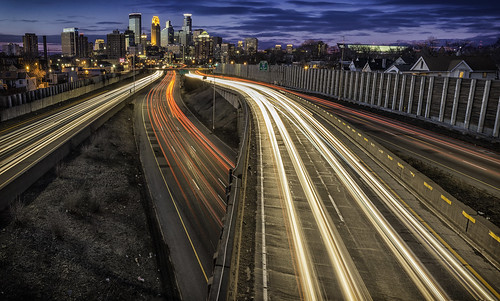 taillights headlights lights car streaks minneapolis minnesota downtown skyline mn 24thstreet bridge footbridge pedestrian twincities city cityscape urban sunset interstate traffic lapse carlights cartrails motion movement light longexposure highway 35w fenceholes mia bryanhansel bluehour trails dananderson