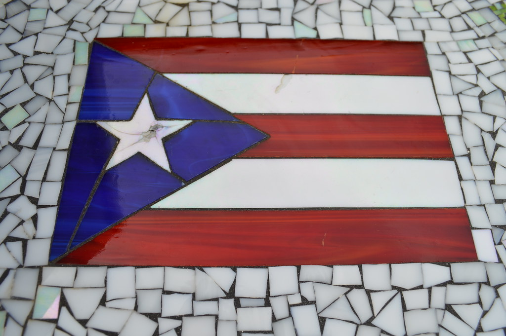 Puerto Rico flag in San Juan Bautista Plaza in the Capital District of Old San Juan, Puerto Rico