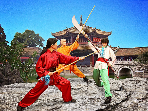 Kung fu fighting with pudao, staff and double head spear