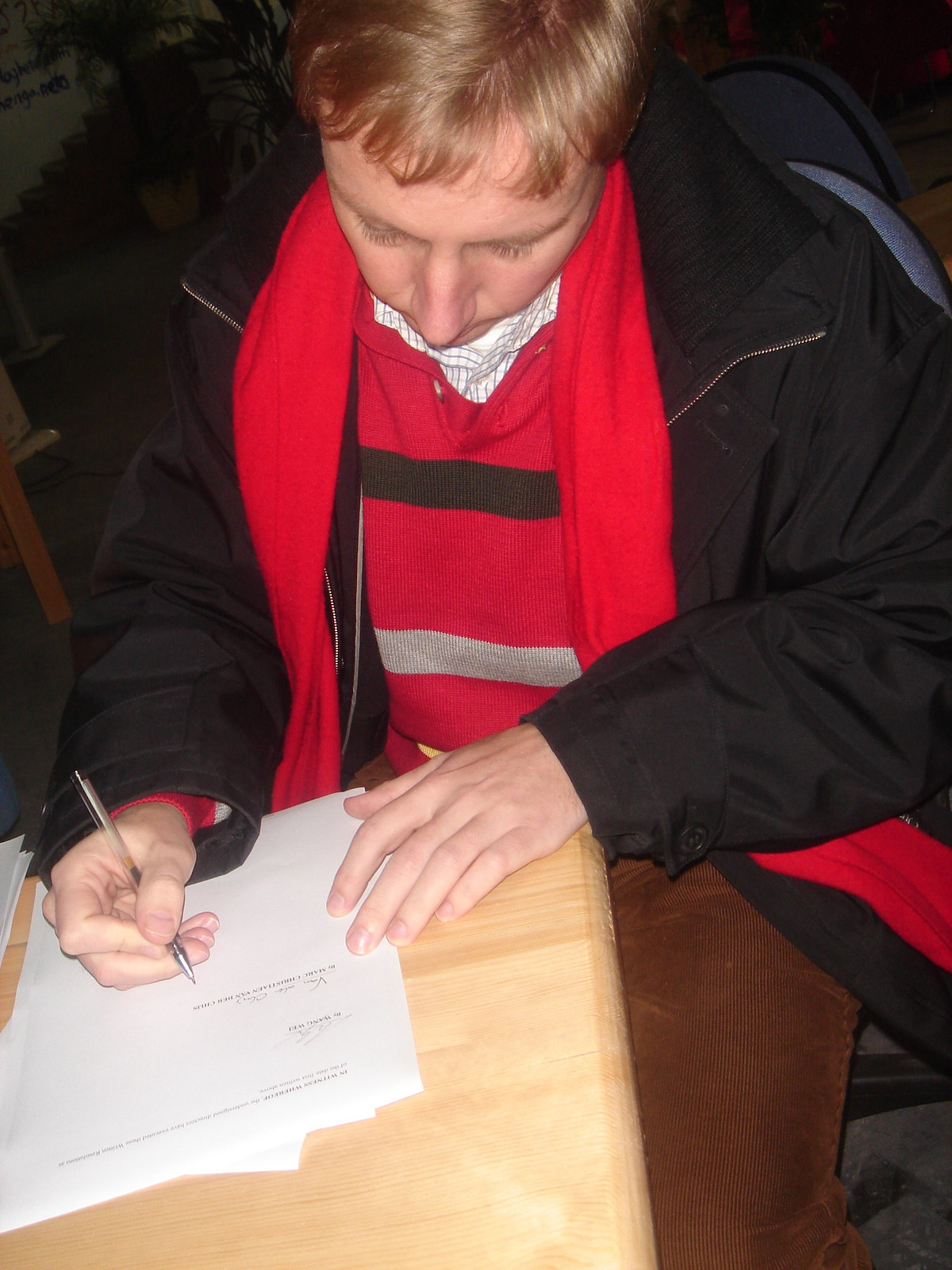 Marc signing the contract