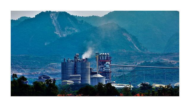 paddy, cement plant and limestone hills. (who will lose?)