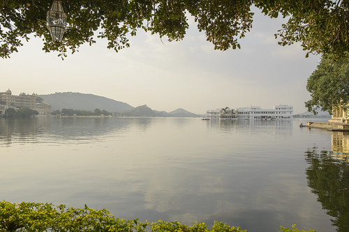 morning india water sunrise reflections rajasthan udaipur lakepichola intrepidtravel
