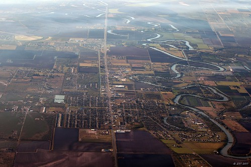 aerial aerialview brotoiah brownsvilletohouston commercialflight flight formerpathofriogrande indianlake lake losfresnos meandering river texas town unitedairlines vacation viewedfromabove windowseat zeesstof