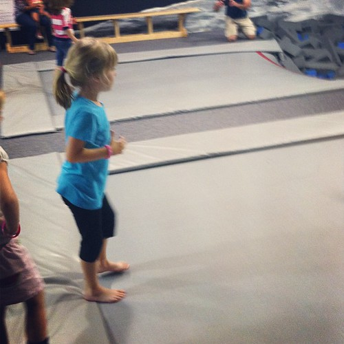 My super cautious girl getting ready to jump off a trampoline into a pit of foam blocks. | by poobou