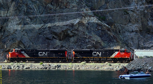 A pair of CN 2800 units leads south bound freight over ex-BCR tracks along Seton Lake shoreline west of Lillooet, BC - 13 July 2013 [photo © WCK-JST]
