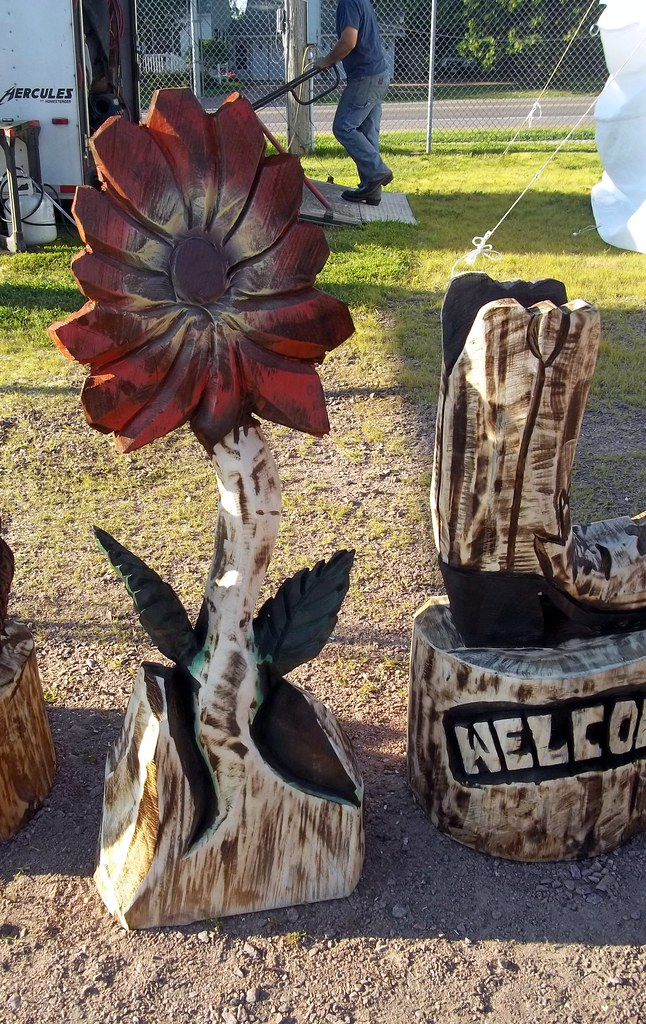 Flower and boot chainsaw carvings mark flickr
