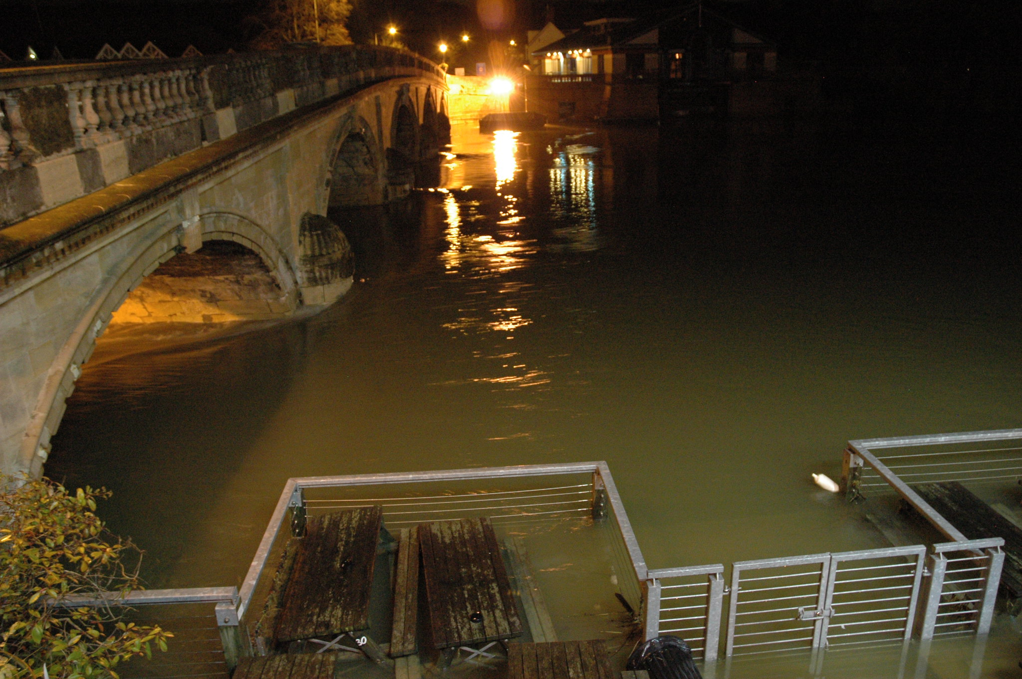 Photo of flooded River Thames at Henley, half-submerging the benches of the Angel pub