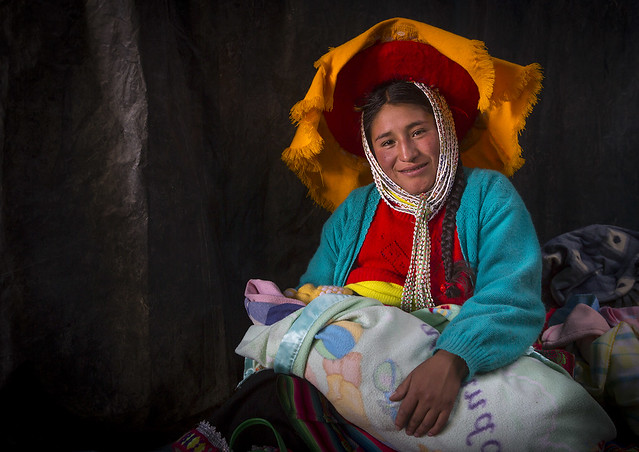Woman In Traditional Clothing With Her Baby, Qoyllur Riti Festival, Ocongate Cuzco, Peru