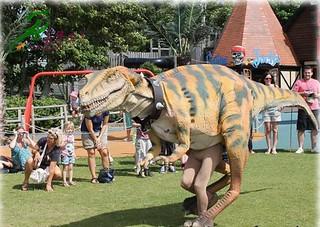 Walking dinosaur in them park