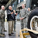 James Ewing, 436th Aerial Port Squadron operations manager, explains the crating and shipping requirements of a C-5 aircraft main landing gear wheel and tire assembly to Chief Master Sgt. of the Air Force James Cody Nov. 18, 2014, on Dover Air Force Base, Del. Cody toured the largest aerial port in the Department of Defense and met with numerous aerial port members. (U.S. Air Force photo/Roland Balik)