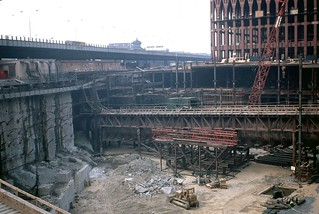 Construction view of the original World Trade Center with the North Tower and the still-open West Side Highway in the background. Looks like the PATH train tube is exposed across the worksite. New York. 1967. | by wavz13