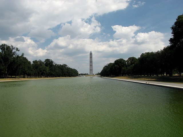 Washington Monument in scaffolding, viewed from the west end of the Lincoln Memorial Reflecting Pool