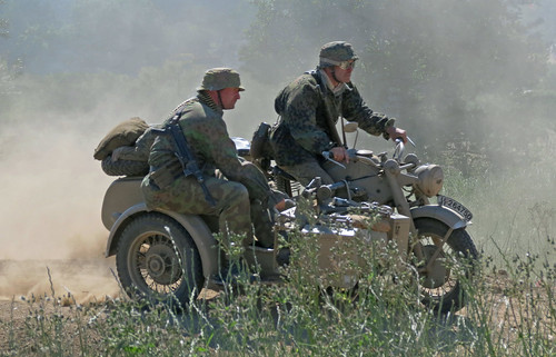 German Motorcycle crew rush into the fray