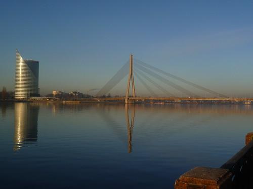 bridge sunset reflections river latvia riga daugava