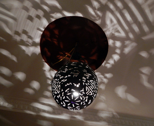 Funky shadows from the pierced light fixture in the Gecko Cafe in Ha Noi, Vietnam