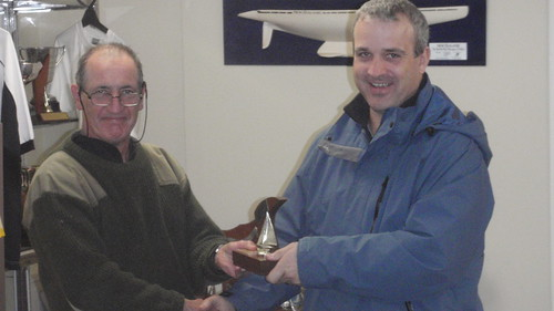 Pete Linford receiving from Will Perry the Secretary Senior Trophy for 1st Senior placing in the Mad Hatter Regatta | by PLSC (Panmure Lagoon Sailing Club)