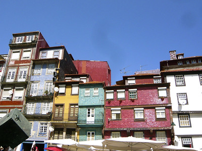 Vibrant colored buildings in Porto against a blue sky